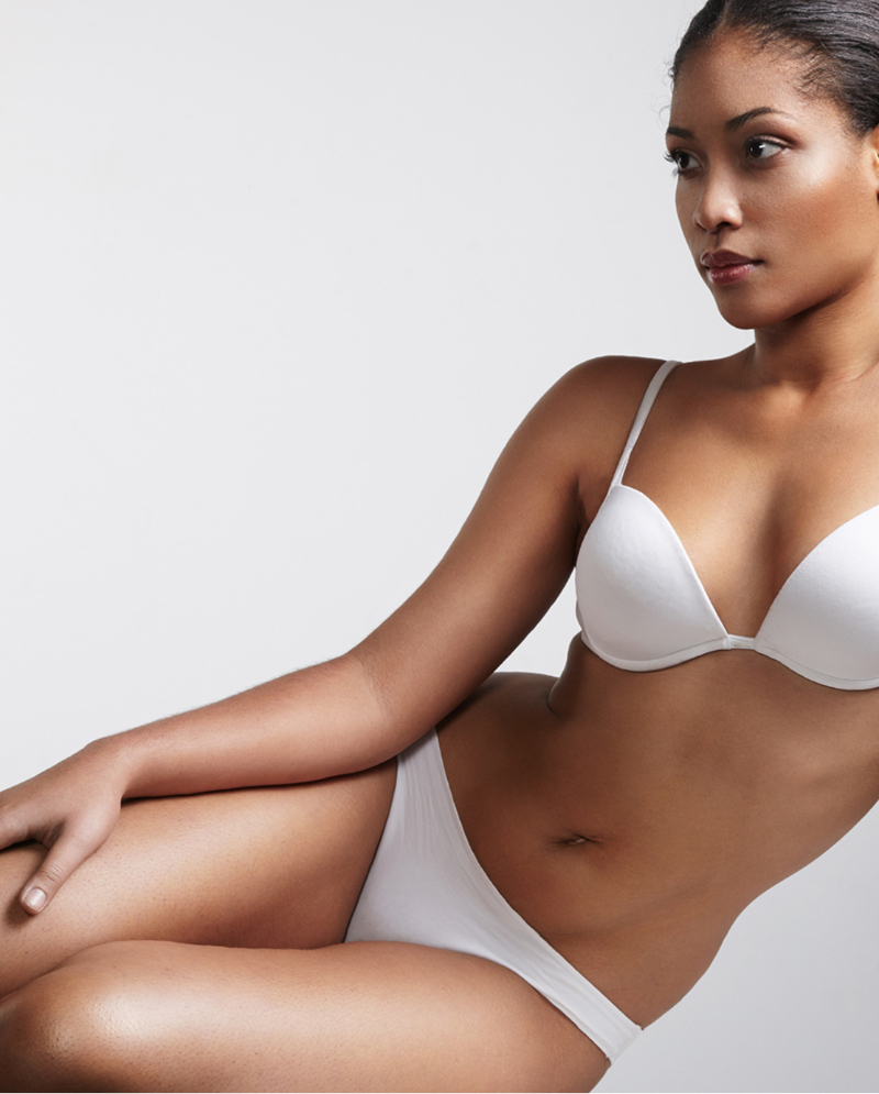 Woman sitting in her bra and underwear after CoolSculpting® body contouring