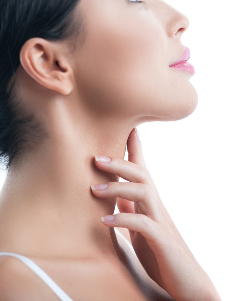 Woman touching her double chin area