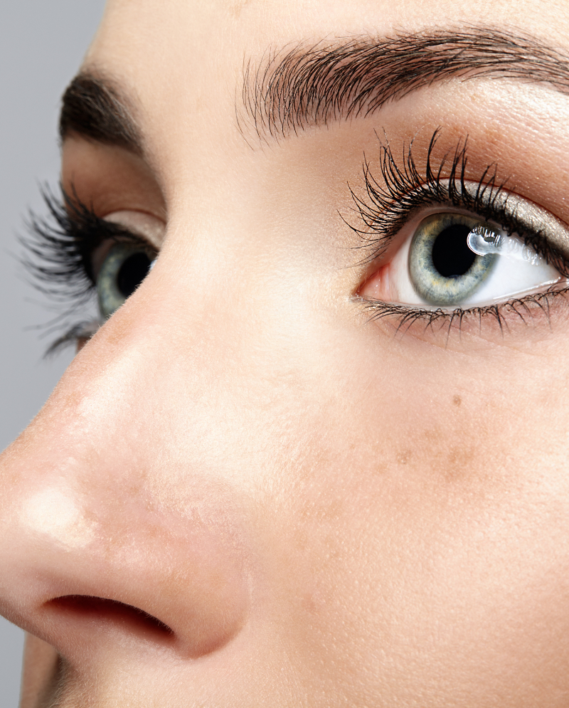 Close-up on a woman's blue eyes