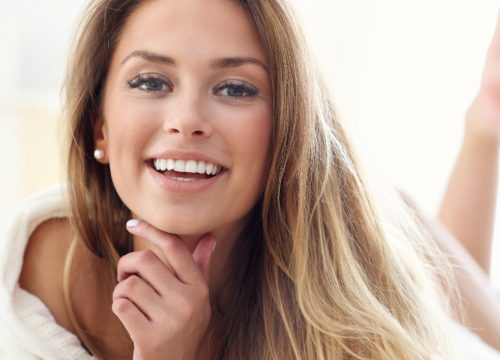 Happy woman with great skin after FORMA skin tightening
