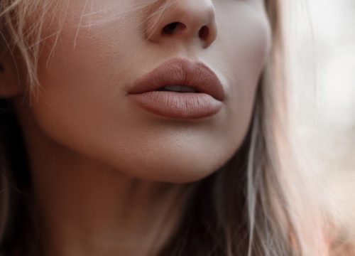 Close-up on a woman's full lips after JUVÉDERM® treatments