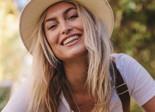 Happy blonde woman after microneedling + prp treatments