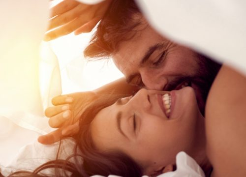 Happy couple in bed after PRP for sexual dysfunction treatments