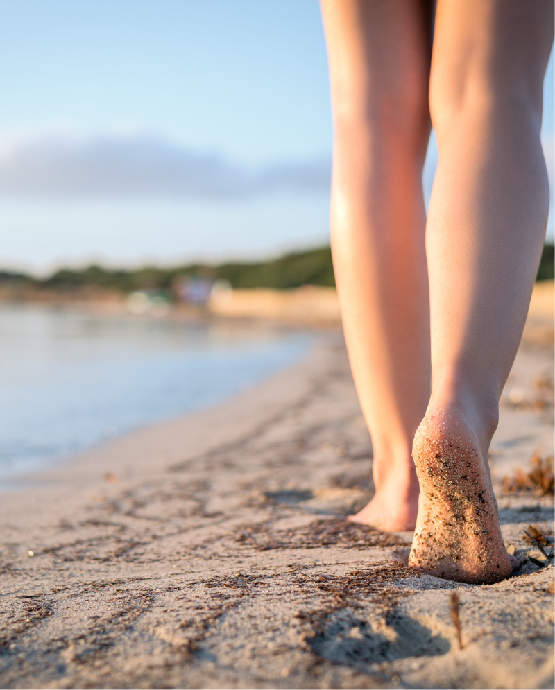 Close-up photo of a woman's legs at the beach