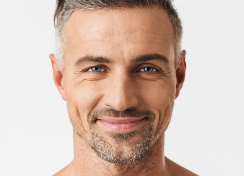 Close-up on a smiling middle-age man with good skin