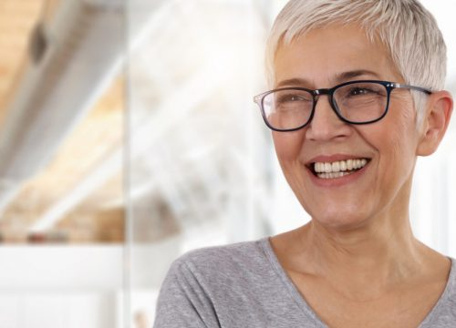 Smiling older woman with short hair and glasses