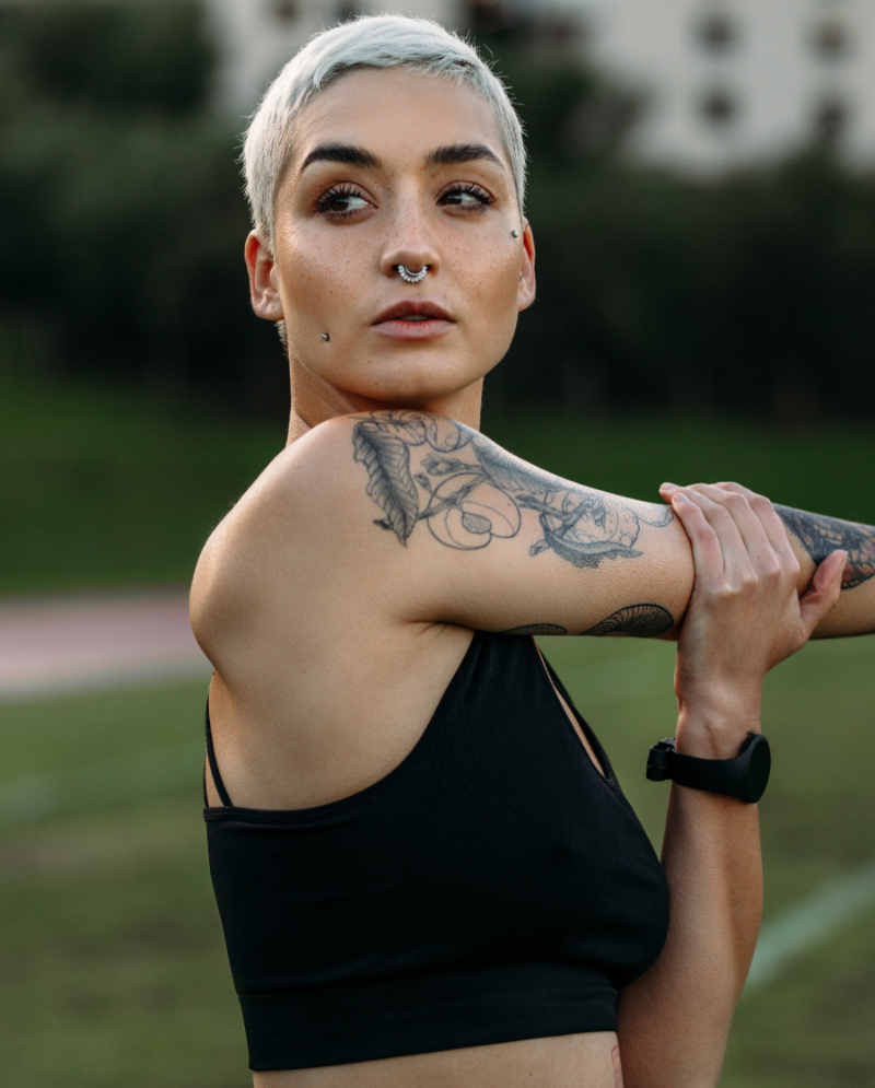 Woman with short, dyed hair and unwanted tattoos